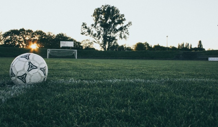 Picture of football in middle of pitch